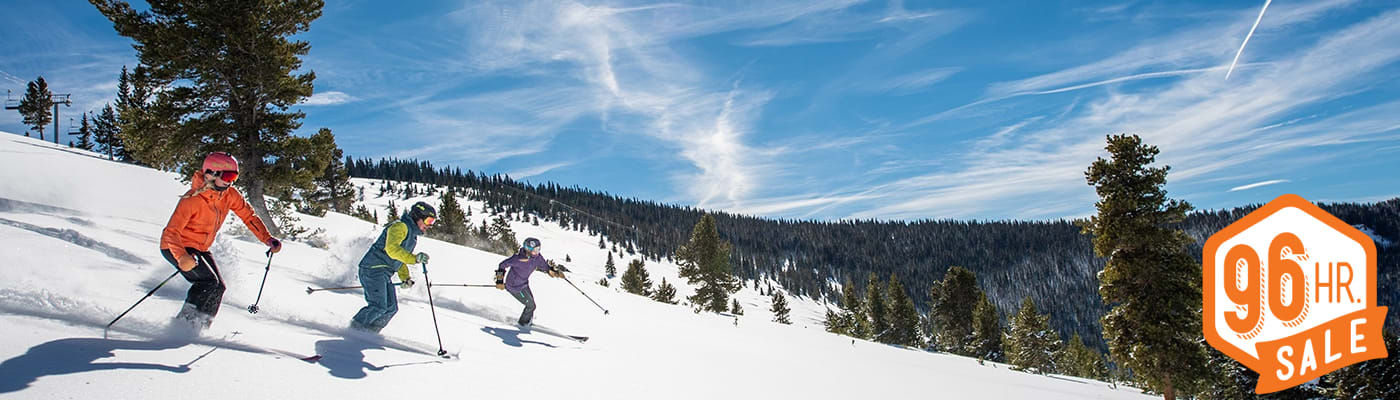 Friends skiing on Vail Mountain