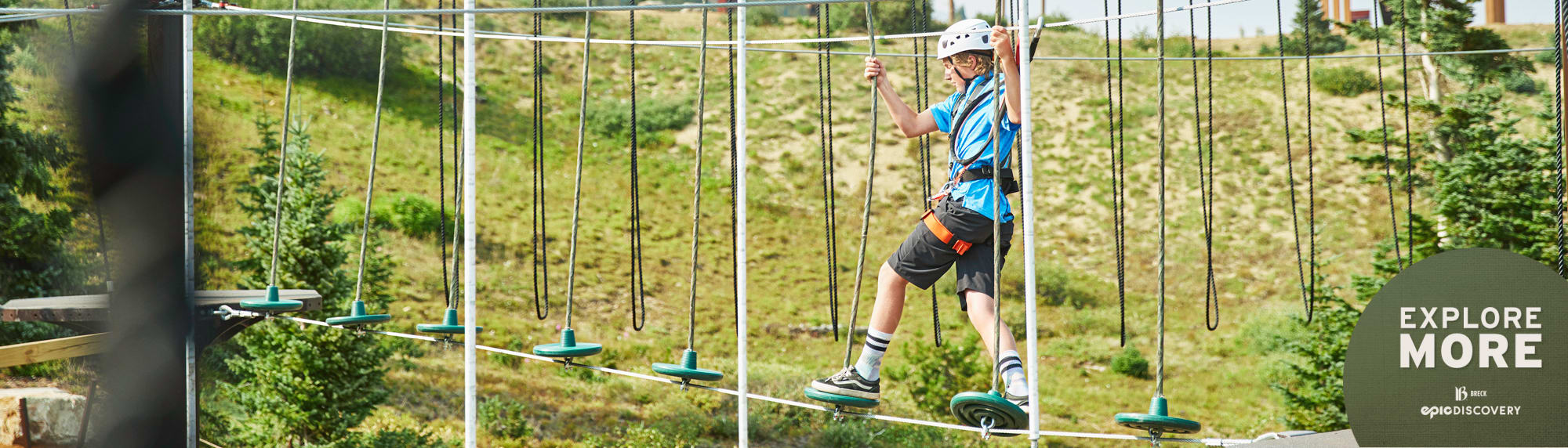 Boy going through the Alpineer Challenge Course.