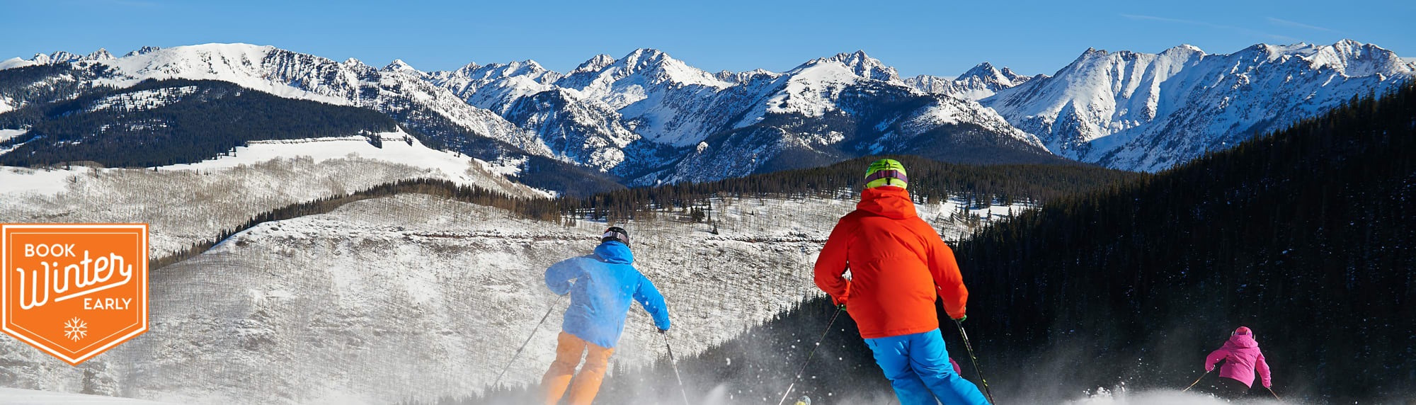 Colorado group skiing scenic view.